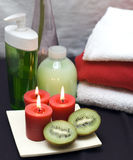 Red and green spa. Spa elements in red green and white colors. Candles and kiwis focused stock image