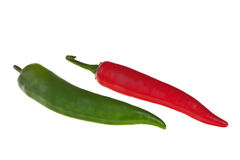 Red and green spicy peppers. Red and green spicy peppers isolated over white background Stock Image