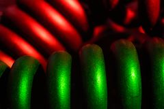 Red and green spiral wire macro. Red and green spiral wire close Royalty Free Stock Image