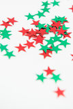 Red Green Star Embellishments. Bright colourful shiny red and green stars. Vibrant colours, star embellishments Royalty Free Stock Photography