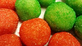 Red and green sugar coated cookie dough balls Stock Photo