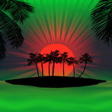 Red and green sunset over tropical island Stock Photo
