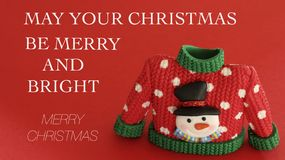 Red and green sweater with snowman on a red background with a Christmas message stock images