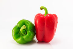 Red and green sweet pepper. Isolated on a white background Royalty Free Stock Photo