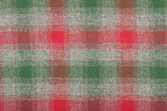 Red and green symmetric square pattern on grey background. Scottish tartan pattern. Wool plaid print as background Stock Photos