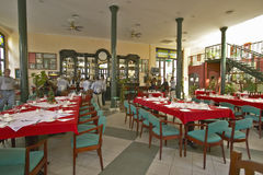 Red and green table settings in restaurant of Old Havana, Cuba Royalty Free Stock Photos