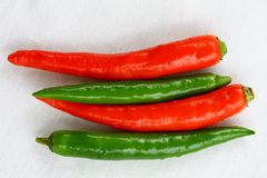 Red and green Thai chili peppers royalty free stock photos