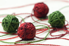 Red and green thread clew balls Royalty Free Stock Photo