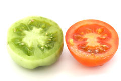Red and green tomatoe slices. Slices of one green and red tomatoes Stock Photo