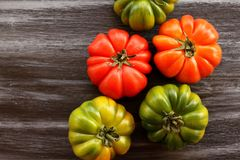 Red and green tomatoes on black table, top view, flat lay Stock Photography