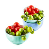 Red and green tomatoes in the dish on white background Stock Images