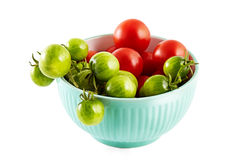 Red and green tomatoes in the dish on white background Stock Photography