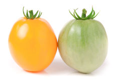 Red and green tomatoes isolated on white background.  Royalty Free Stock Image