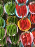Red or green?. A top shot of green and red chilies taken at a local market in Selangor Malaysia Stock Images