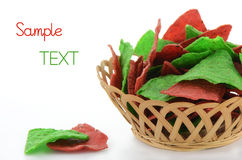 Red and green tortilla chips. Festive red and green tortilla chips for holiday snacking on white background with space for your text Stock Photo