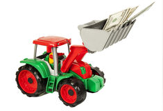 Red and green toy bulldozer with dollars Royalty Free Stock Photography
