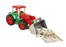 Red and green toy bulldozer with dollars and euro Stock Photos