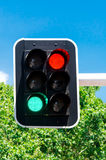 Red and green traffic lights on blue sky Stock Photos