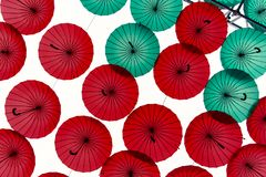 Red and green umbrellas against . Beautiful colorful umbrellas or parasols with red and green canopies and crook handles. Beautiful colorful umbrellas or stock image