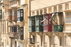 Red and green Valletta balconies. Red and green balconies located in Valletta, Malta.  These historic architectural features are typical of this historic city Stock Image