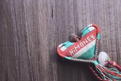 Red, Green, and White Knitted Decor Stock Image