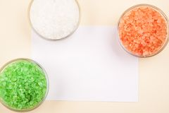 Red, green and white sea salt in glass bowls closeup, text space.  royalty free stock photo
