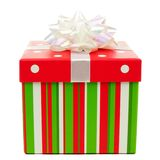 Red, green and white striped Christmas gift box over white Royalty Free Stock Photos