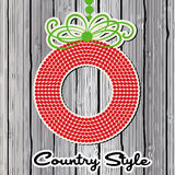 Red and Green wreath over wooden planks Royalty Free Stock Photo
