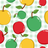 Red, Green and Yellow Apples on Tablecloth Royalty Free Stock Photography