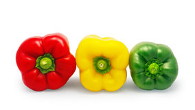 Red, green and yellow bell pepper isolated on white background Royalty Free Stock Photos