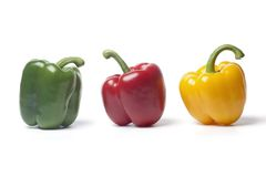 Red,green,yellow bell pepper on a row Royalty Free Stock Images