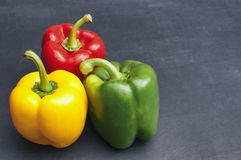 Red, Green and Yellow Bell Peppers Stock Photography