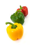 Red, green and yellow bell peppers isolated on wh Stock Photo
