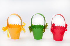 Red, green and yellow carton baskets for easter eggs Royalty Free Stock Photos
