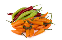 Red, green and yellow chili peppers Royalty Free Stock Photos