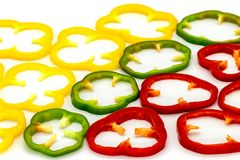 Red, Green and Yellow chilli slices separated on a white background royalty free stock photo