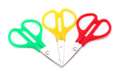 Red, green and yellow little scissors Royalty Free Stock Photos