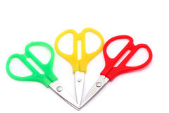 Red, green and yellow little scissors Stock Images