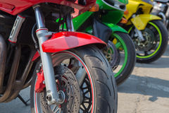 Red green and yellow motorcycle Stock Photo