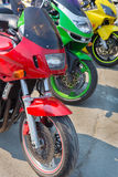 Red green and yellow motorcycle Royalty Free Stock Photo