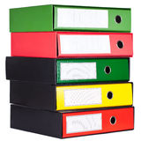 Red, green and yellow office folders in boxes Stock Image