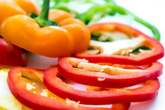 Red, green, yellow, orange bell pepper slices Stock Photography