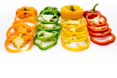 Red, green, yellow, orange bell pepper slices Stock Images