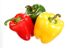 Red, green and yellow pepper closeup, isolated Royalty Free Stock Images