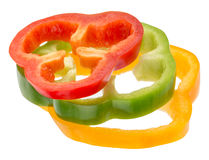 Red, green and yellow pepper slices isolared on the white background Stock Images