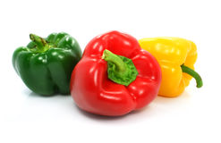 Red green and yellow pepper vegetables isolated. On the white background Stock Photos