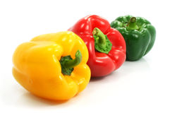 Red green and yellow pepper vegetables isolated. Red green and yellow pepper vegetables set isolated on the white background Stock Image