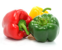 Red green and yellow pepper vegetables still-life. Red green and yellow pepper vegetables still life isolated on the white background Royalty Free Stock Images