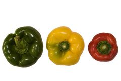 Red, green and yellow pepper on white Stock Images