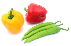 Red green and yellow pepper on a white ba. Photo of red green and yellow pepper on a white background Royalty Free Stock Images